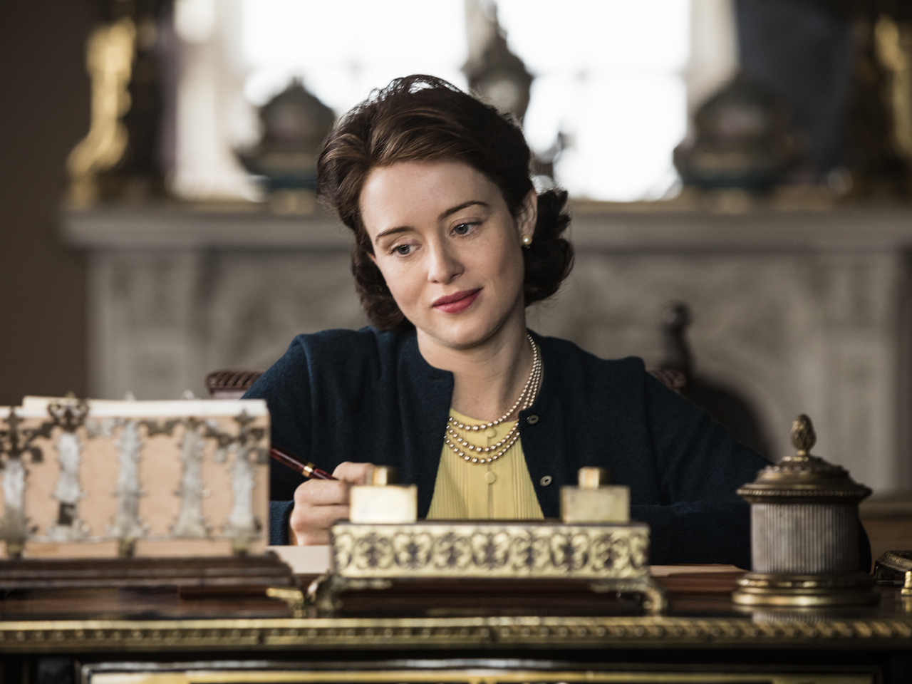 The Crown season 2 royals - Elizabeth writes a note to Philip