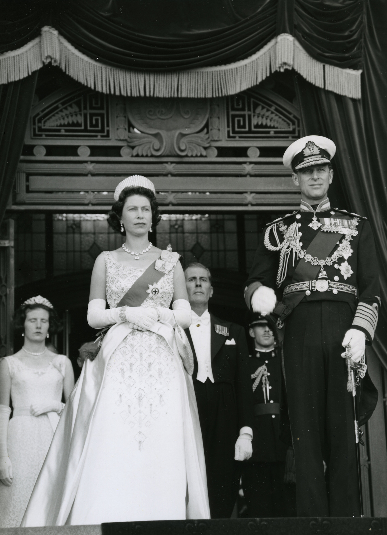The Crown season 2 royals - Queen Elizabeth II and the Duke of Edinburg are pictured here in 1963 at the opening of the New Zealand parliament. (Photo, Archives New Zealand)