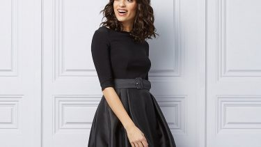 Holiday Dresses-woman wears a black boat-neck fit & flare cocktail dress