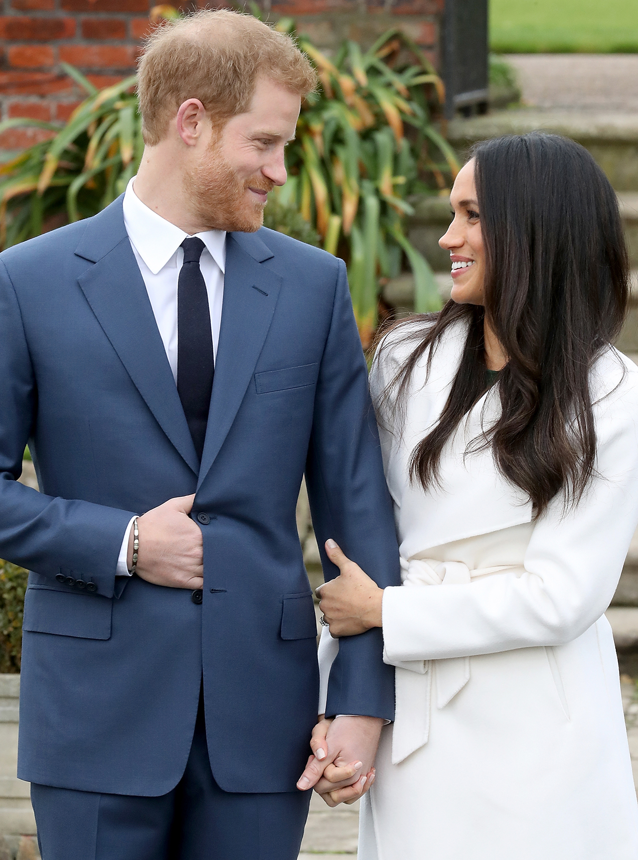 Prince Harry and actress Meghan Markle during an official photocall to announce their engagement at The Sunken Gardens at Kensington Palace on November 27, 2017. (Chris Jackson / Chris Jackson / Getty Images)