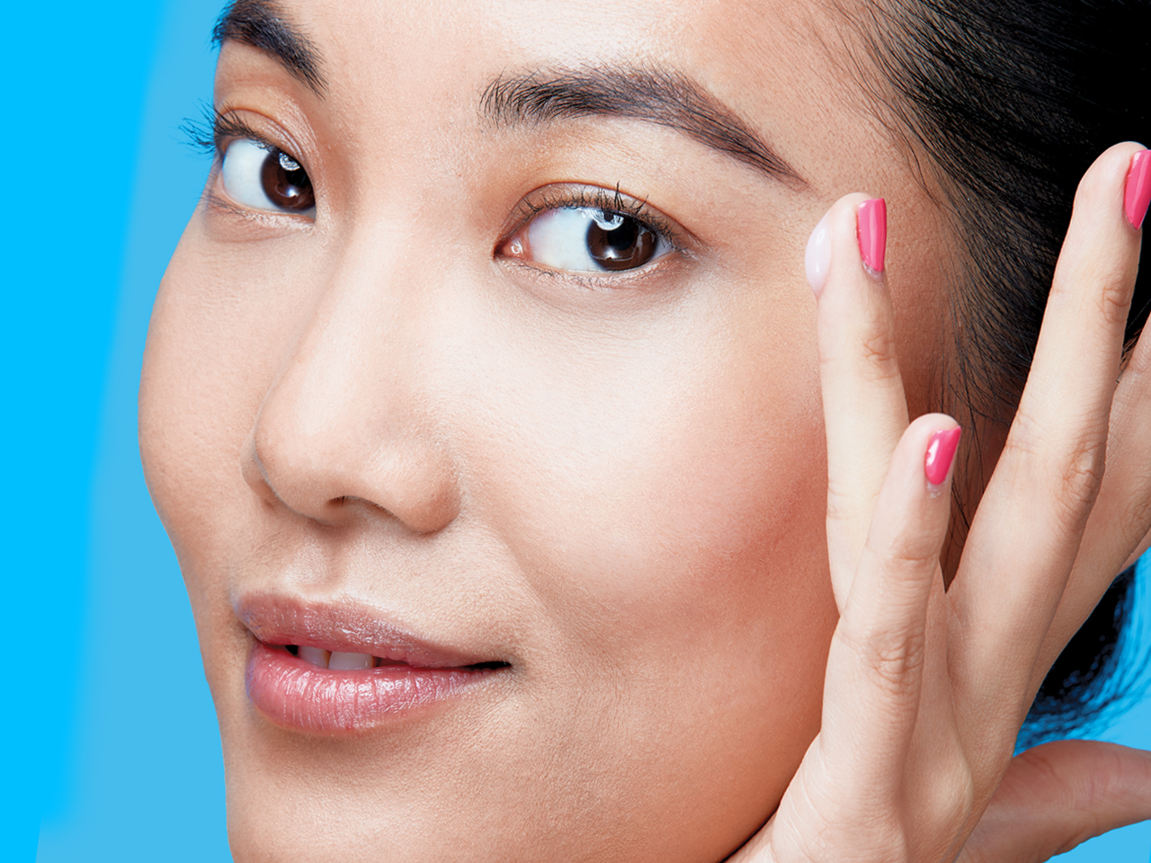 woman applying cream to her face for Anti-Aging Skincare Products