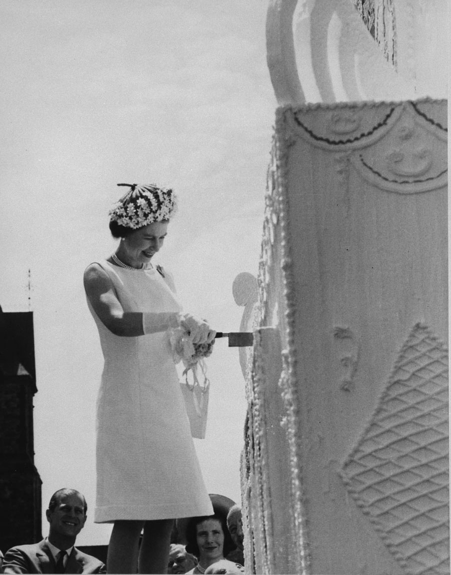 Her Majesty Queen Elizabeth cuts the cake, July 1st, at the Centennial Party on Parliament Hill 1 July 1967. (Dominion Wide / Library and Archives Canada )