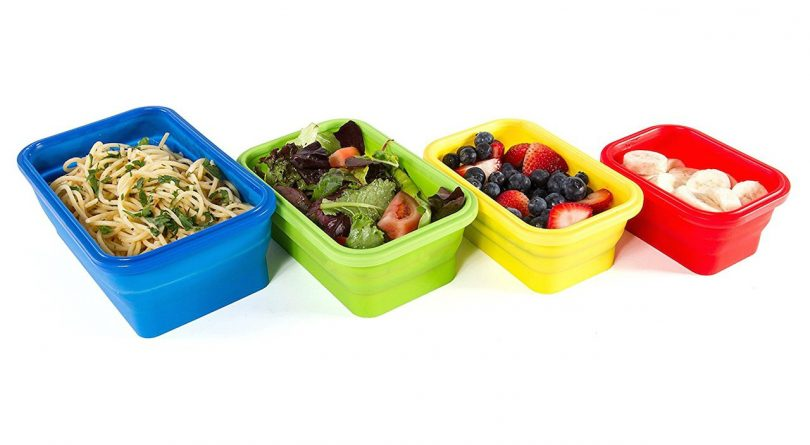 spaghetti, salad, berries, and bananas in tupperware containers