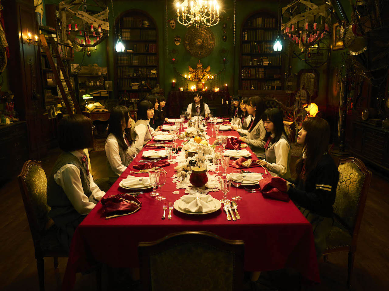 Netflix February-ReMind scene of all characters sitting at large ornate dinner table