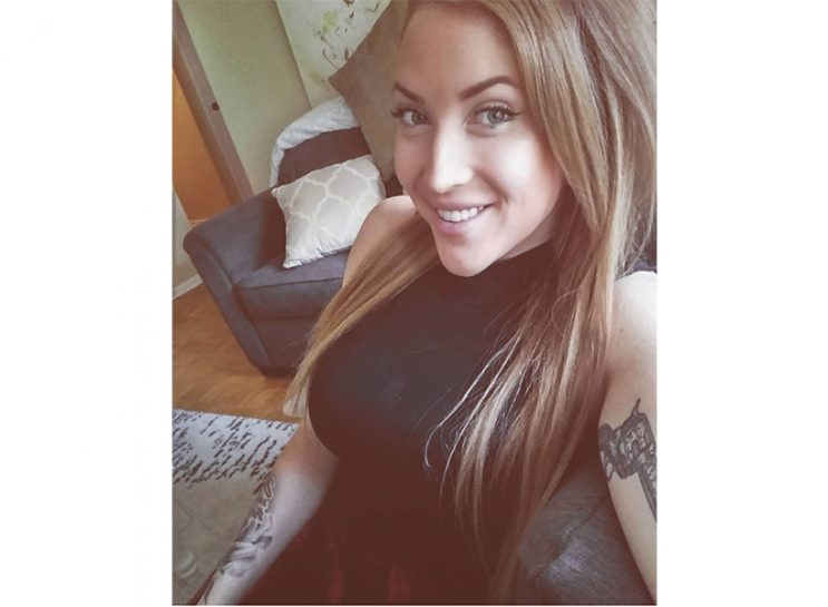 human trafficking- Markie Dell wearingblack shirt and long hair at 26 years old
