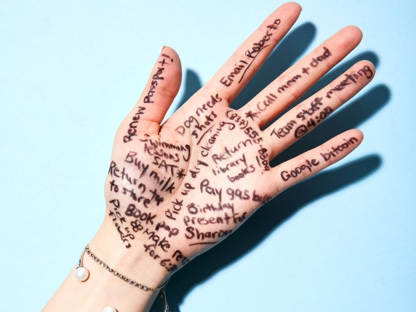 improve memory- a hand with notes written in black sharpie all over it