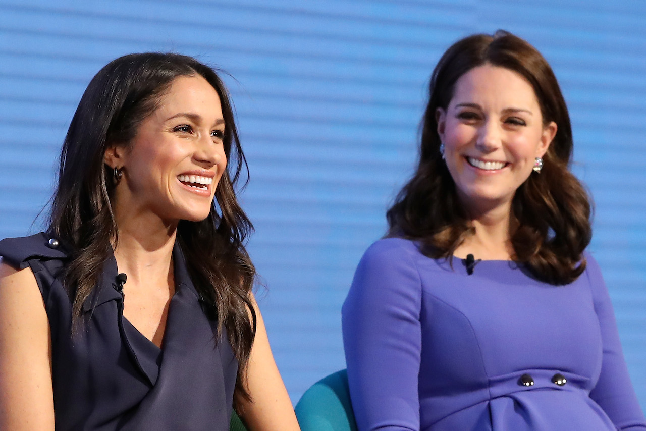 Meghan Markle Kate Middleton first join engagement- the two laugh together in matching blue dresses