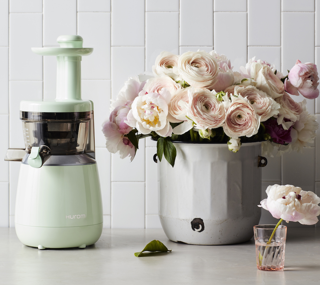 Hurom HP slow juicer in mint green