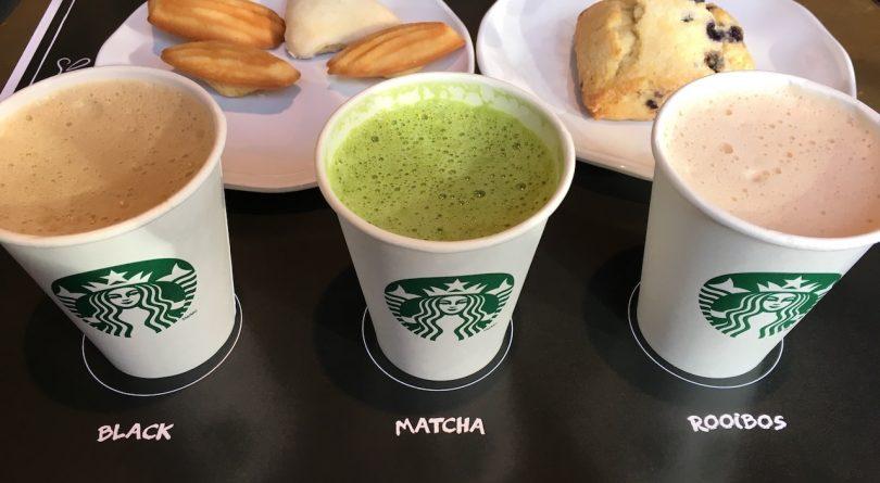 Three new Starbucks tea lattes on black table