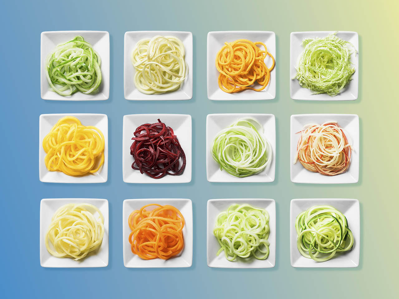 Grocery shopping: Spiralized vegetables on small square white plates