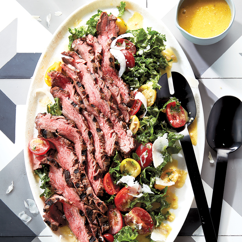 Grilled flank steak with kale caesar salad