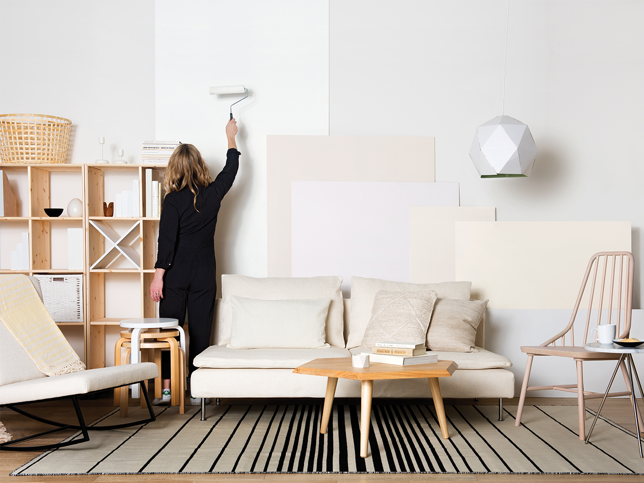 Woman painting with neutral paint colours
