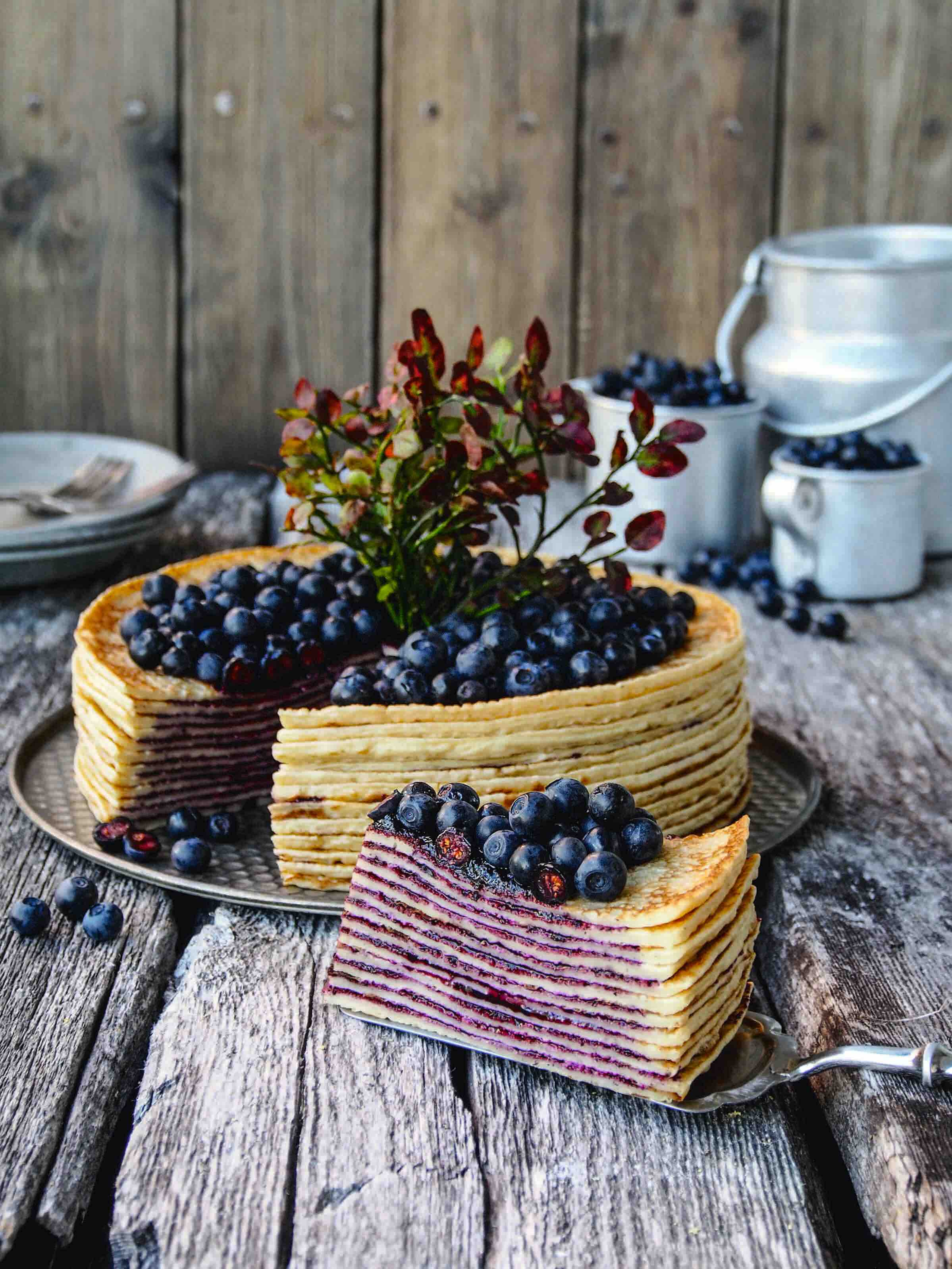 Crepe cake topped with blueberries.