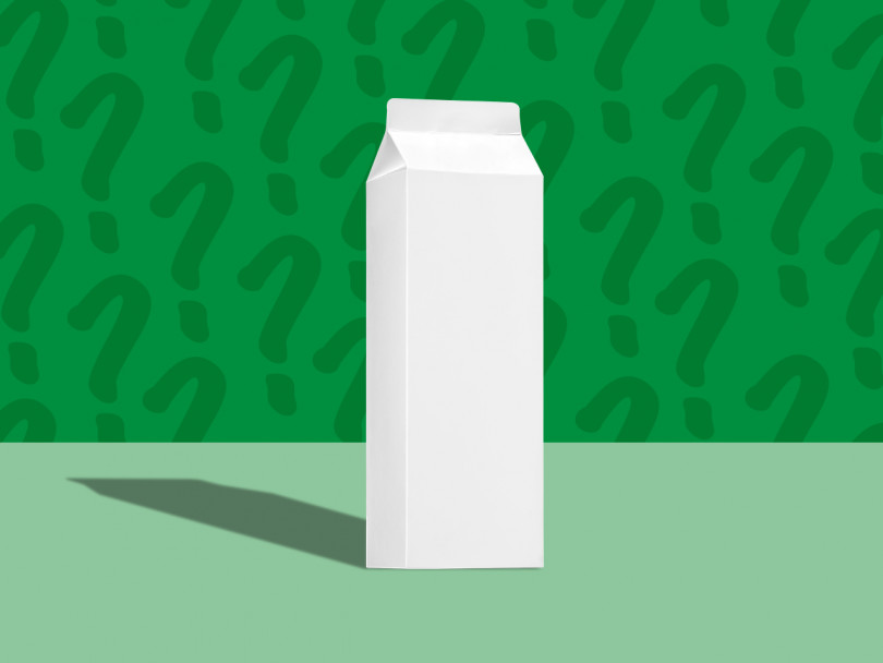 Carton of milk on green backhground