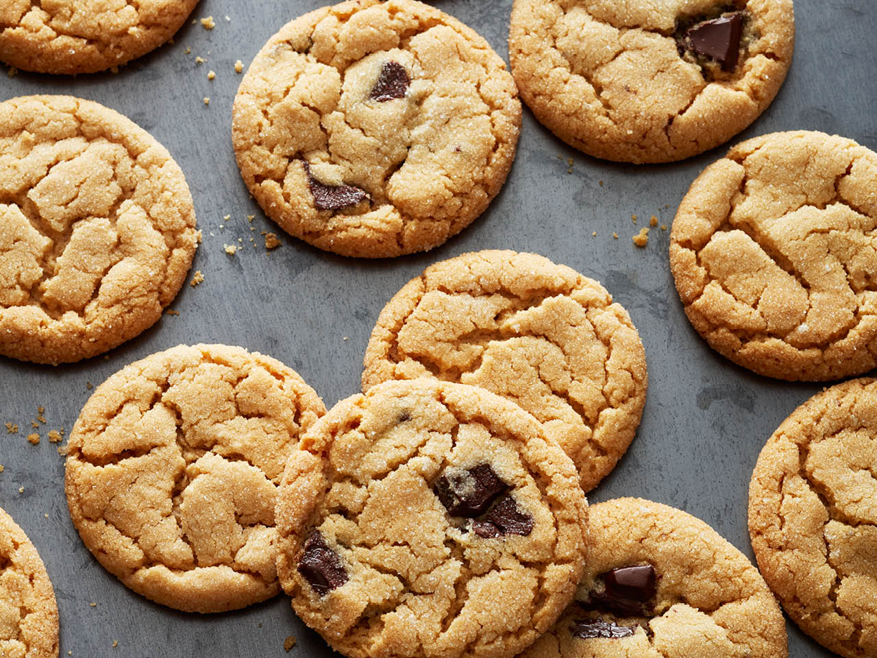 Chatelaine' best cookie recipes: classic peanut butter cookies and peanut butter cookies with chocolate chunks on a silver cookie sheet