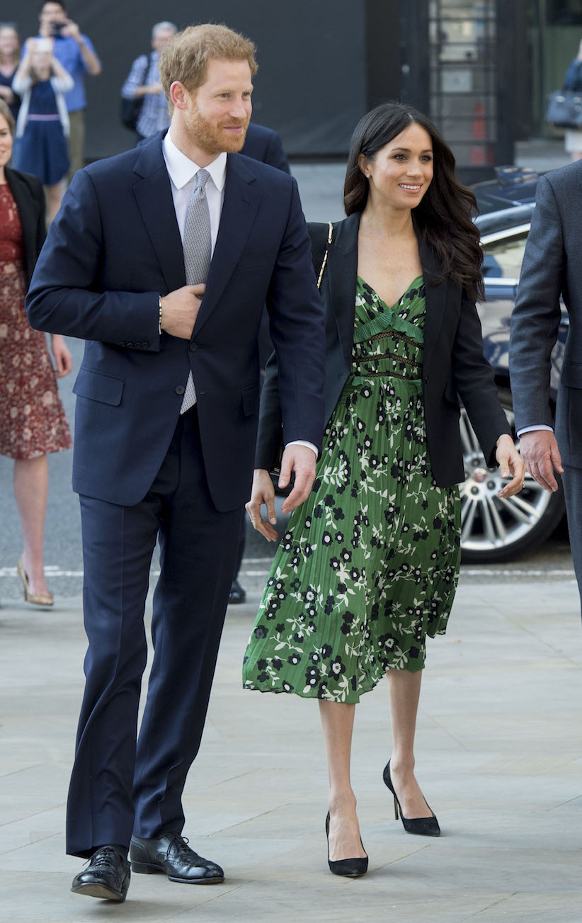 Prince Harry and Meghan Markle, shown with bare legs