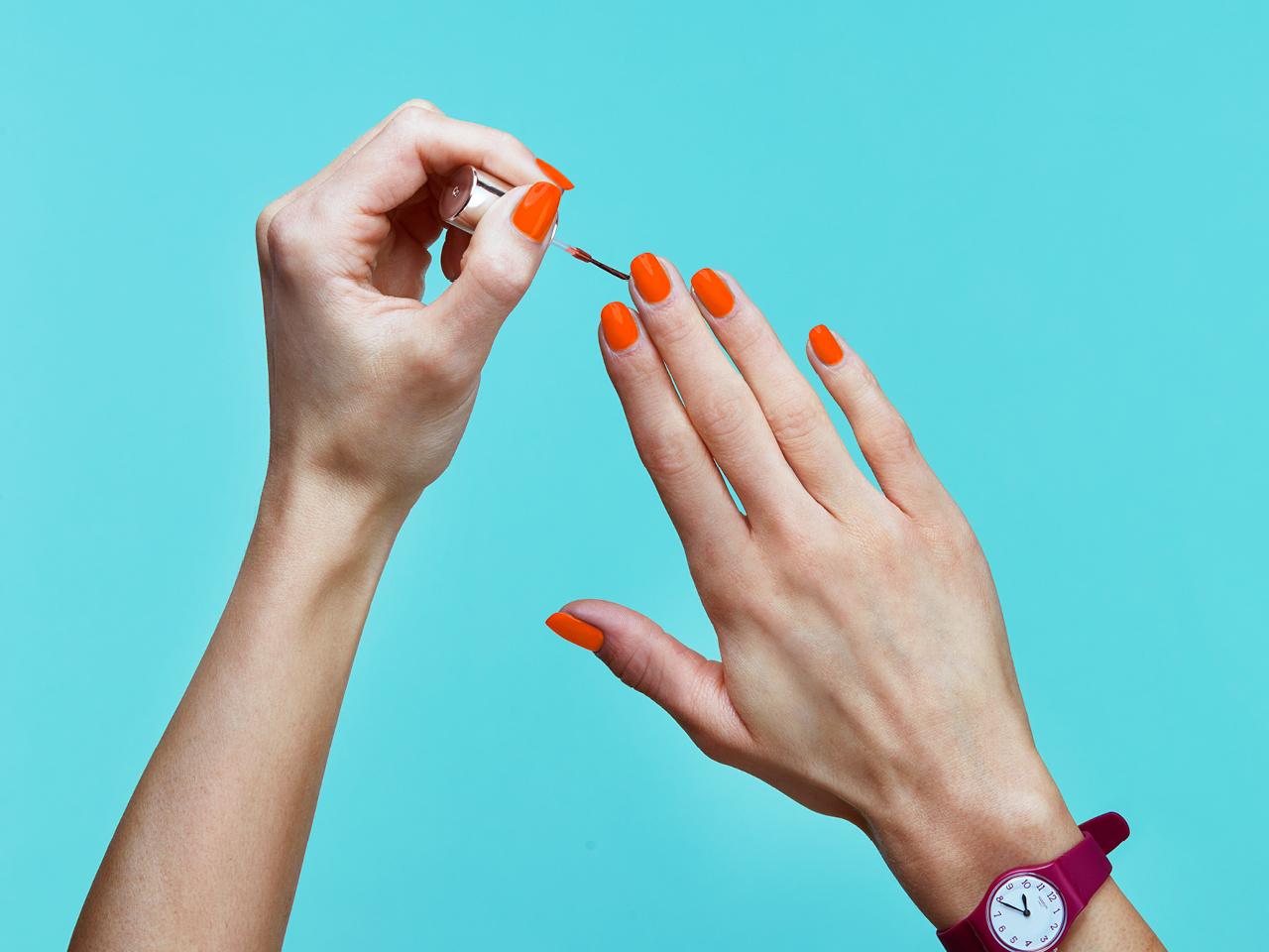 one of the biggest beauty trends for spring is orange nail polish