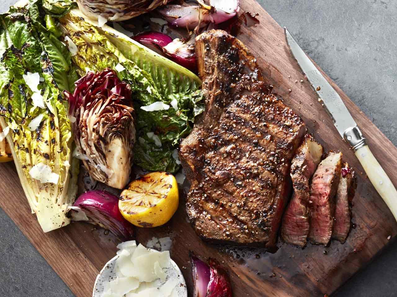 Grilled steak with caesar salad