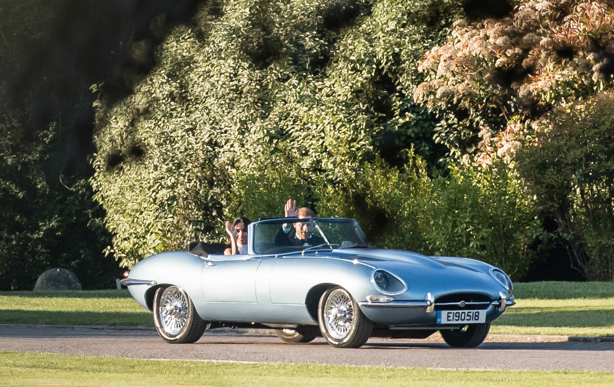 Meghan Markle and Prince Harry in a silver blue Jaguar E-Type Concept Zero