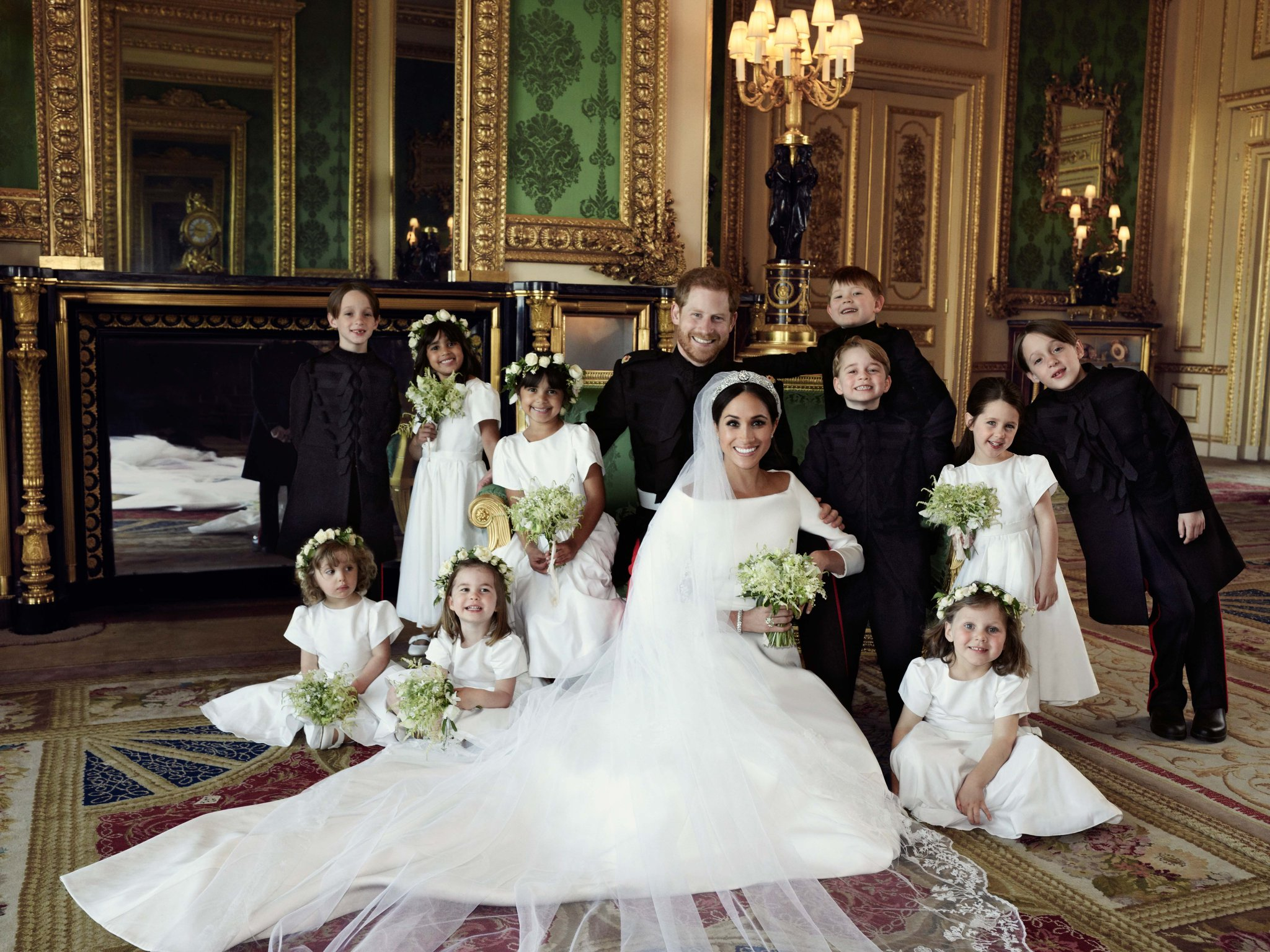Meghan Markle, Prince Harry as the Duke and Duchess of Sussex in their wedding portrait with pageboys and bridesmaids