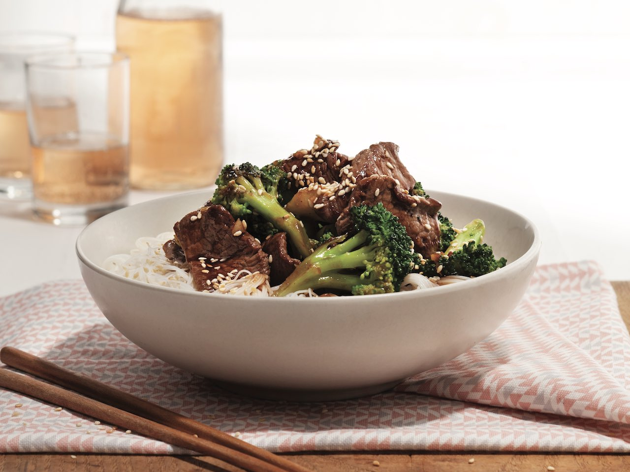 Vermicelli bowl with sesame beef and broccoli