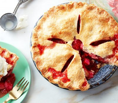 strawberry rhubarb pie with a slice missing