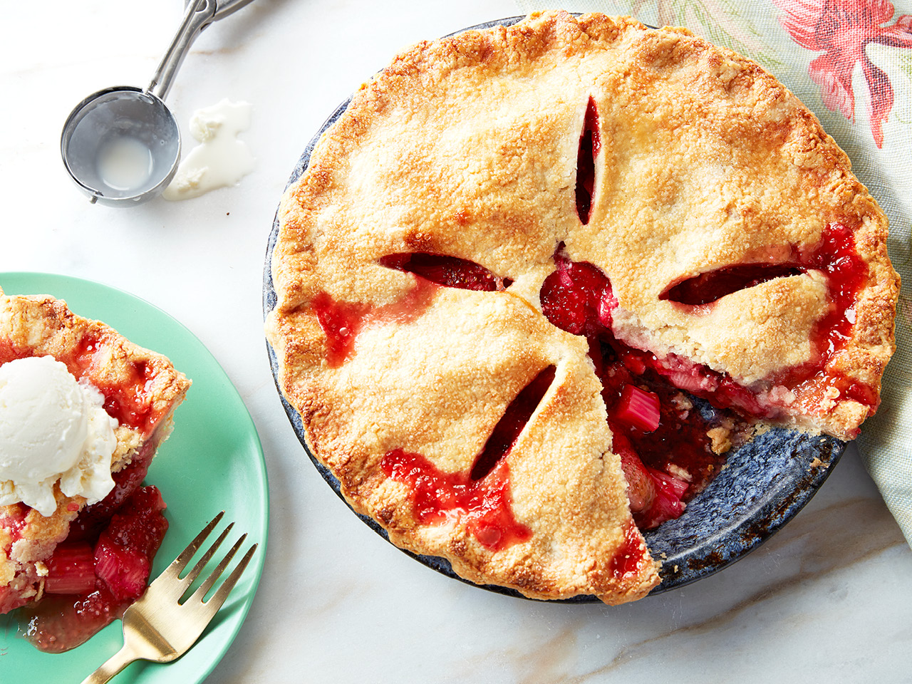 Strawberry rhubarb pie with a slice cut out