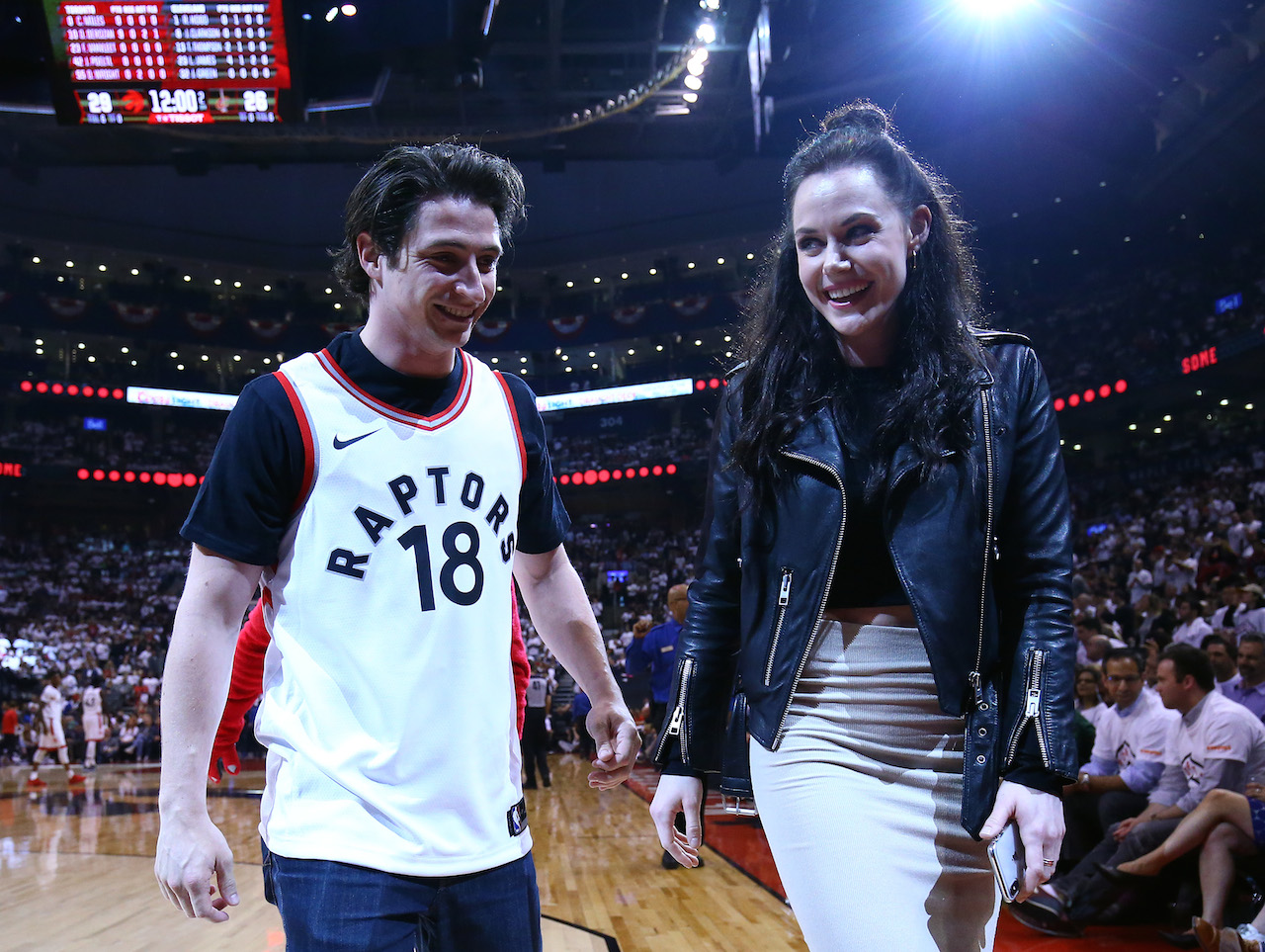 Tessa Virtue Scott Moir - the two stand on the raptors court in Toronto