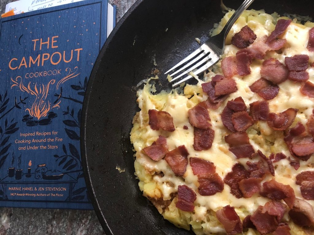 The Campout Cookbook Smokey Smashed Potatoes and The Campout Cookbook sit side by side