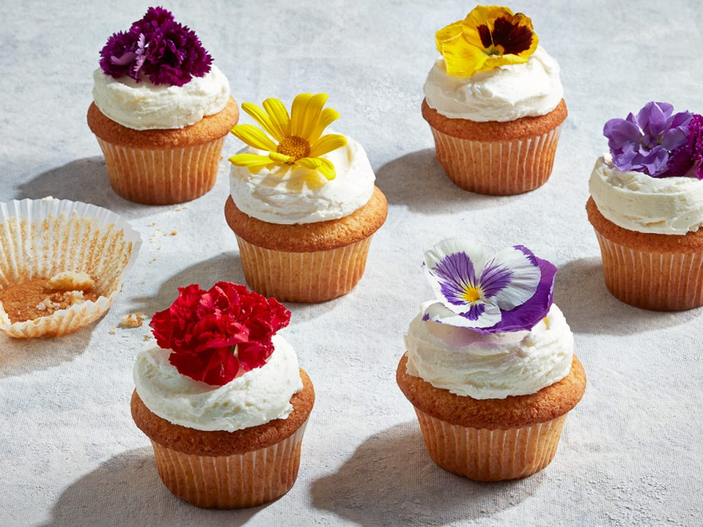 Lemon elderflower cupcakes topped with icing and flowers