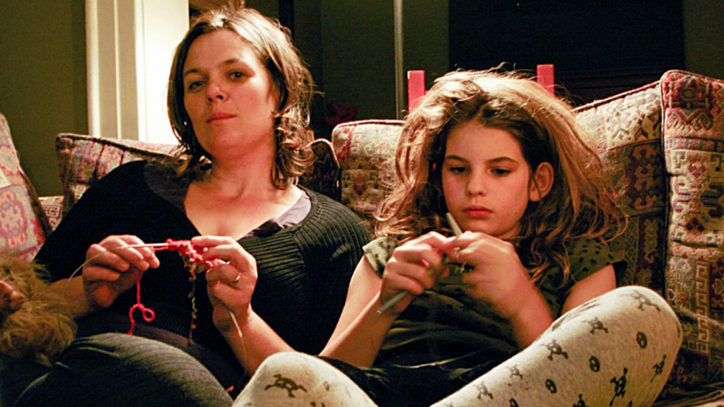 Only child died-writer and her daughter sit knitting side by side