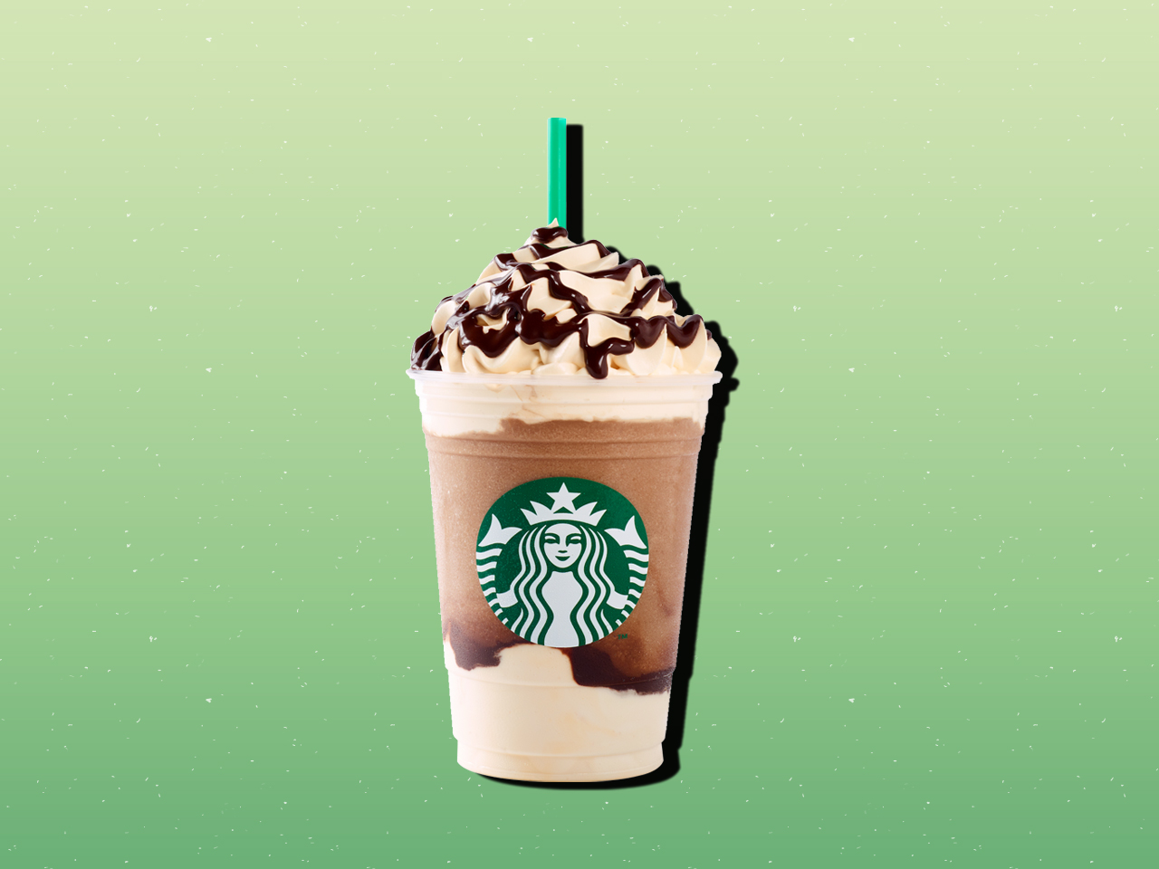 Starbucks mocha frappuccino on green background