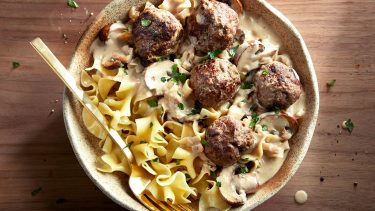 easy dinner recipes-saucy swedish meatballs and egg noddles with sauce in a bowl