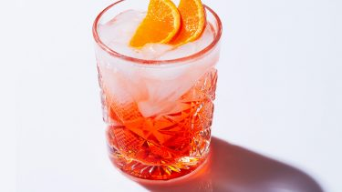 Aperol spritz topped with orange wedges