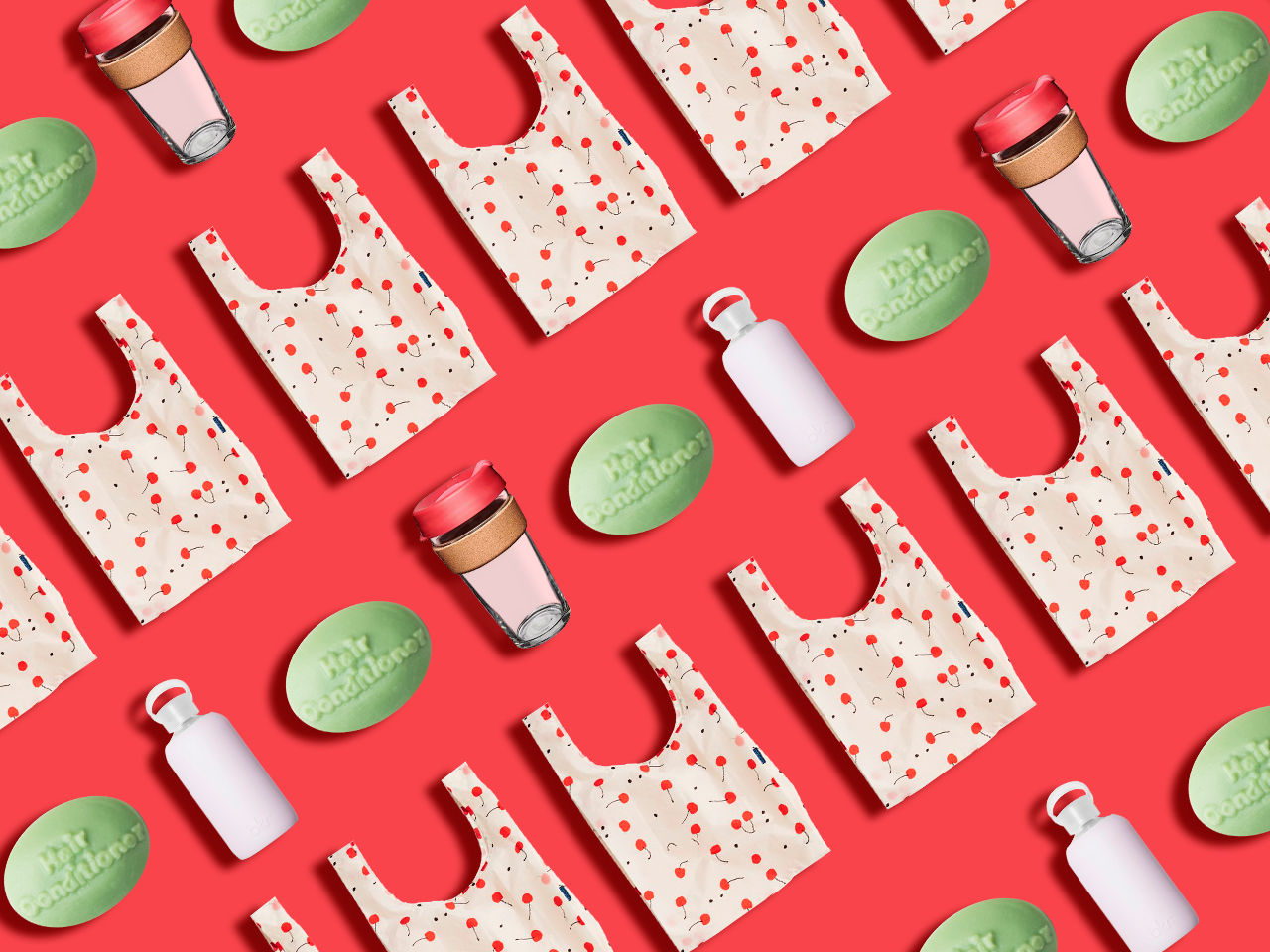 Re-usable products that can help you reduce your plastic waste: a cherry Baggu tote, Lush conditioner bar, KeepCup, and Bkr water bottle