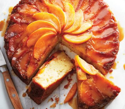 Peach upside-down cake with two slices cut out