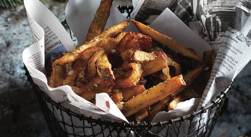 French fries in basket with newspaper lining.