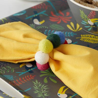 Wool pompom napkin ring from Simon's Maison