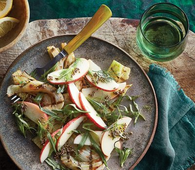 Grilled apple salad on a stoneware plate
