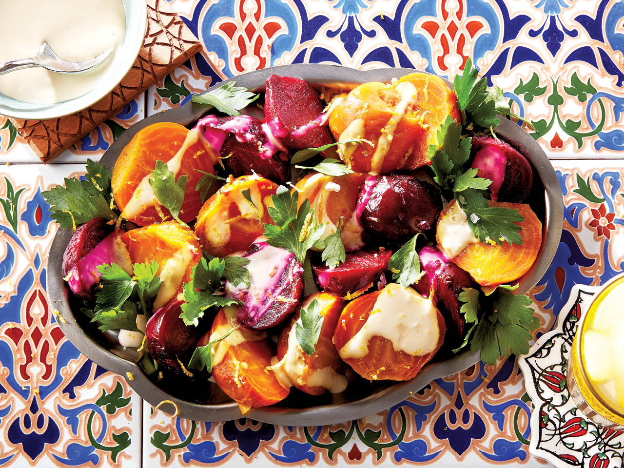 Bowl of brightly coloured beets on blue and red tiles