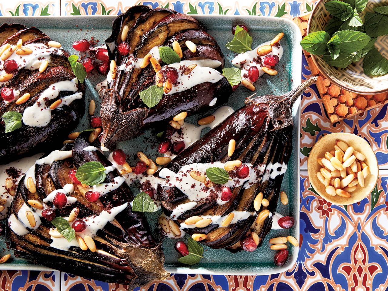 Plate of roasted eggplant drizzled with tahini sauce