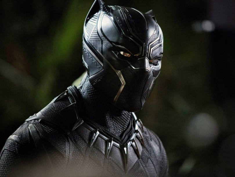 Chadwick Boseman as Black Panther. A piece asks whether it's OK for any child to wear a Black Panther Halloween costume
