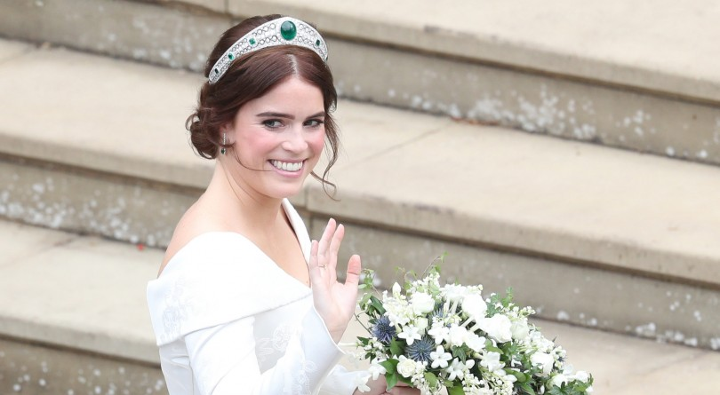 Princess Eugenie's waves at her wedding in emerald studded tiara from queen's royal jewellery vaults