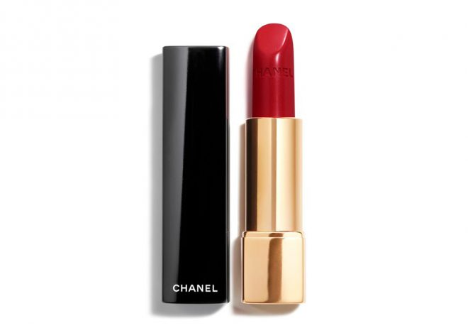 A red Chanel lipstick in a gold bullet on a white background to illustrate an article on how much you should really spend on makeup.