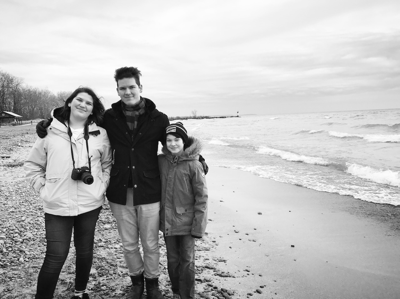trans daughter-Amanda's three children pose on a wintery beach in Prince Edward County.