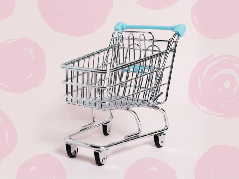 mindless shopping-empty shopping cart on a pink background