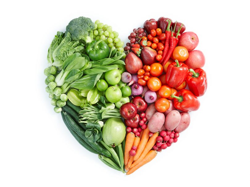 Vegetables and fruit arranged in a heart. The new Planetary Health Diet argues we need to drastically cut back on meat