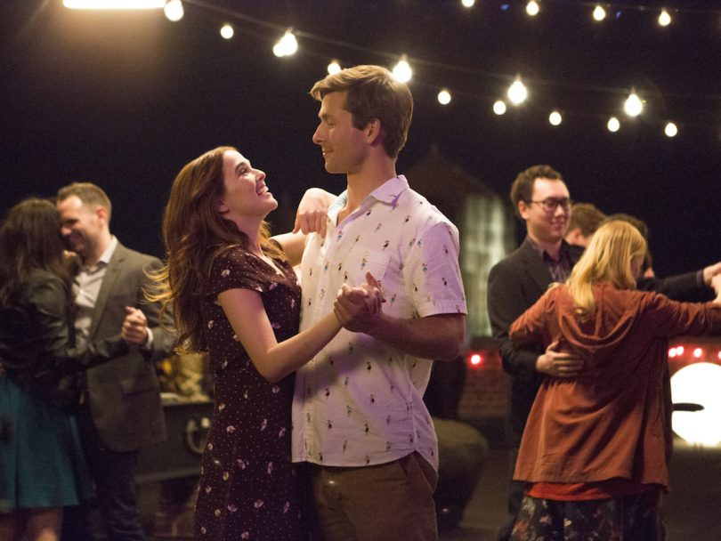 netflix rom-coms- Zoey Deutch and Glen Powell slow dance in a still from the movie Set It Up