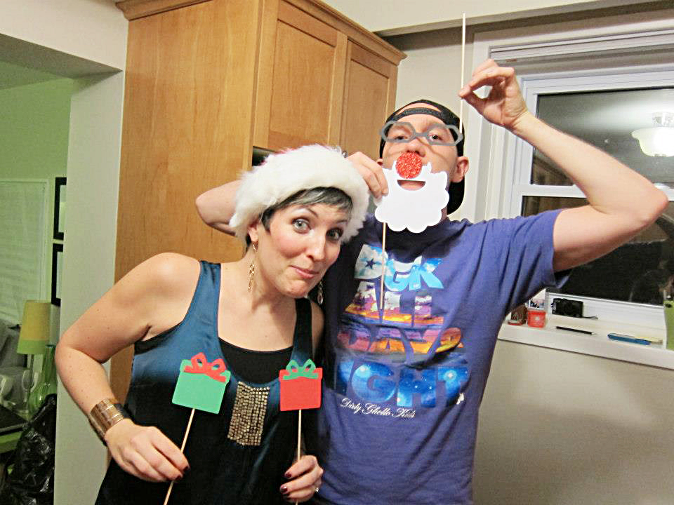 opioid addiction stigma-two adults wear christmas hats and fake white santa beards