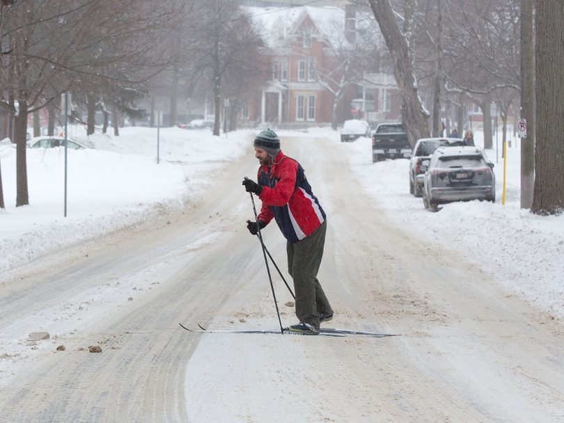 A man skis on the street in Kingston, Ontario. The extreme cold is tied to a polar vortex; climate change makes extreme weather more likely